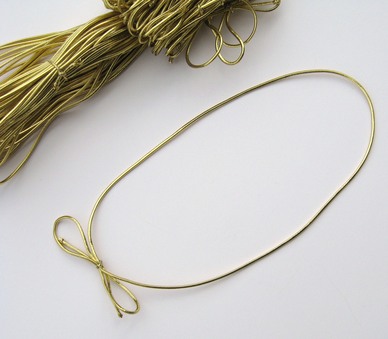 "19"" Gold Stretch Loops per 100 - SKU: 645303"